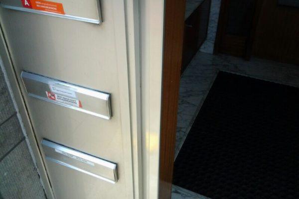 blank aluminium deur gerepareerd